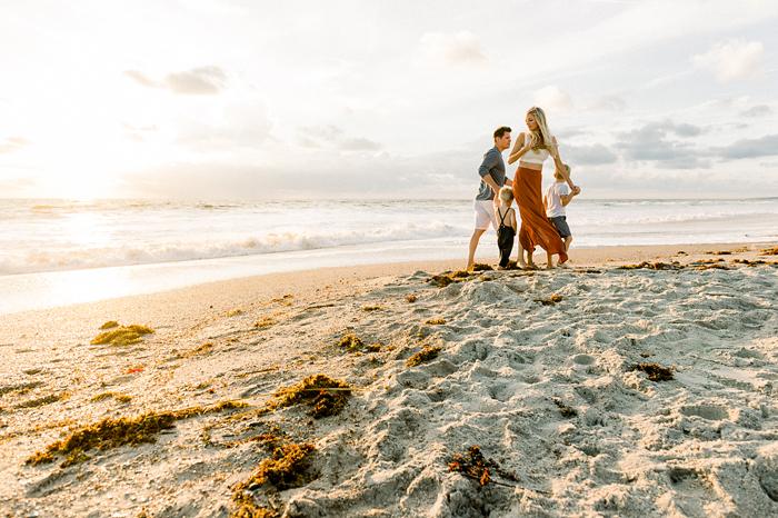 family on Florida beach at sunrise