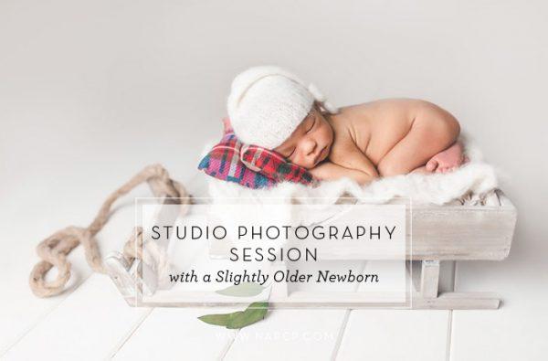 studio photography session with slightly older newborn