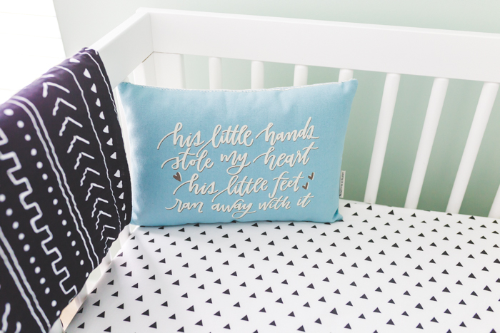 boho baby boy pillow in crib with tribal details