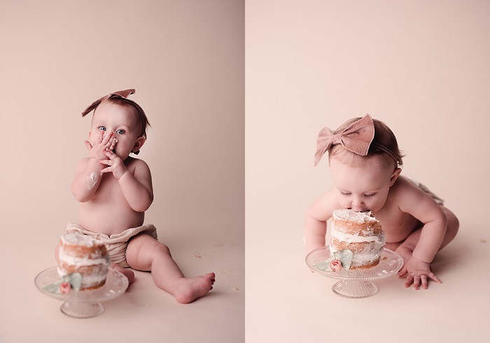 one year-old eating cake