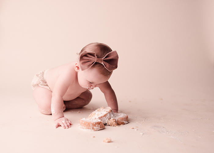 one year-old diving into cake