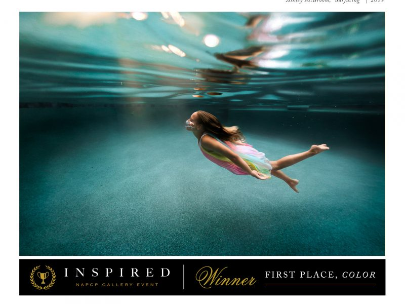 girl surfacing from under water