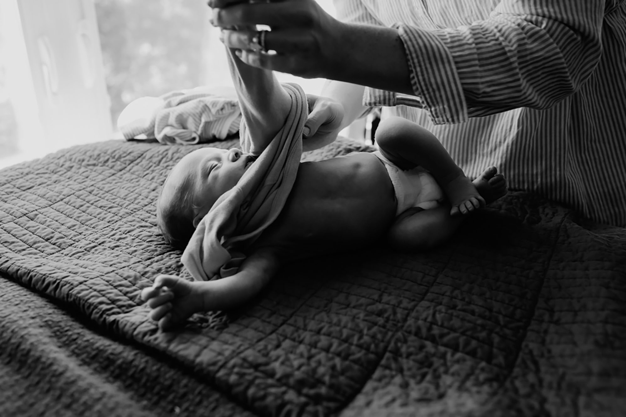 documentary, newborn lifestyle photography, black and white, Beth Ann Fricker, changing baby