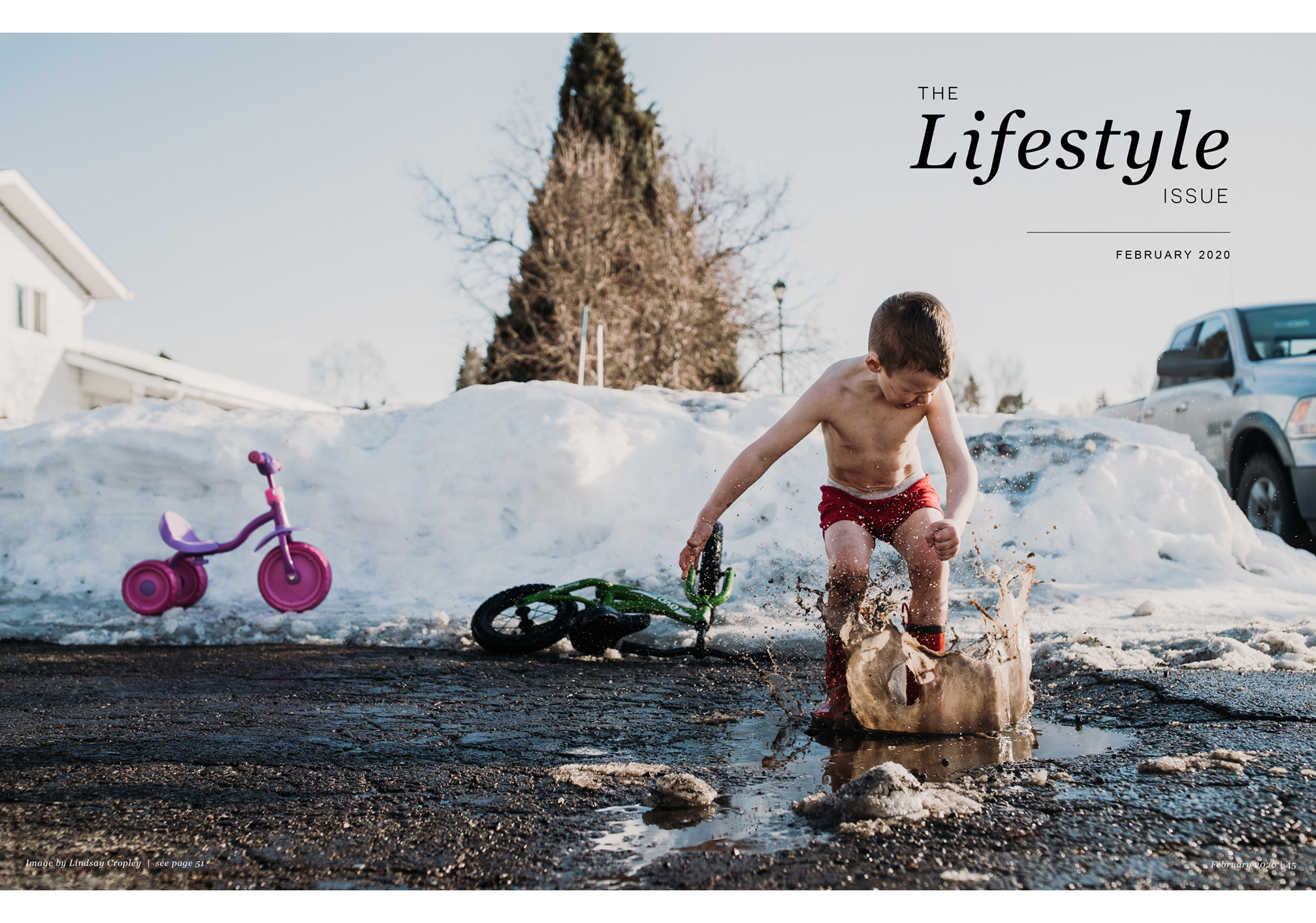 The Lifestyle Issue, February 2020, boy jumping in mud, snow pile, truck, tricycle, bike