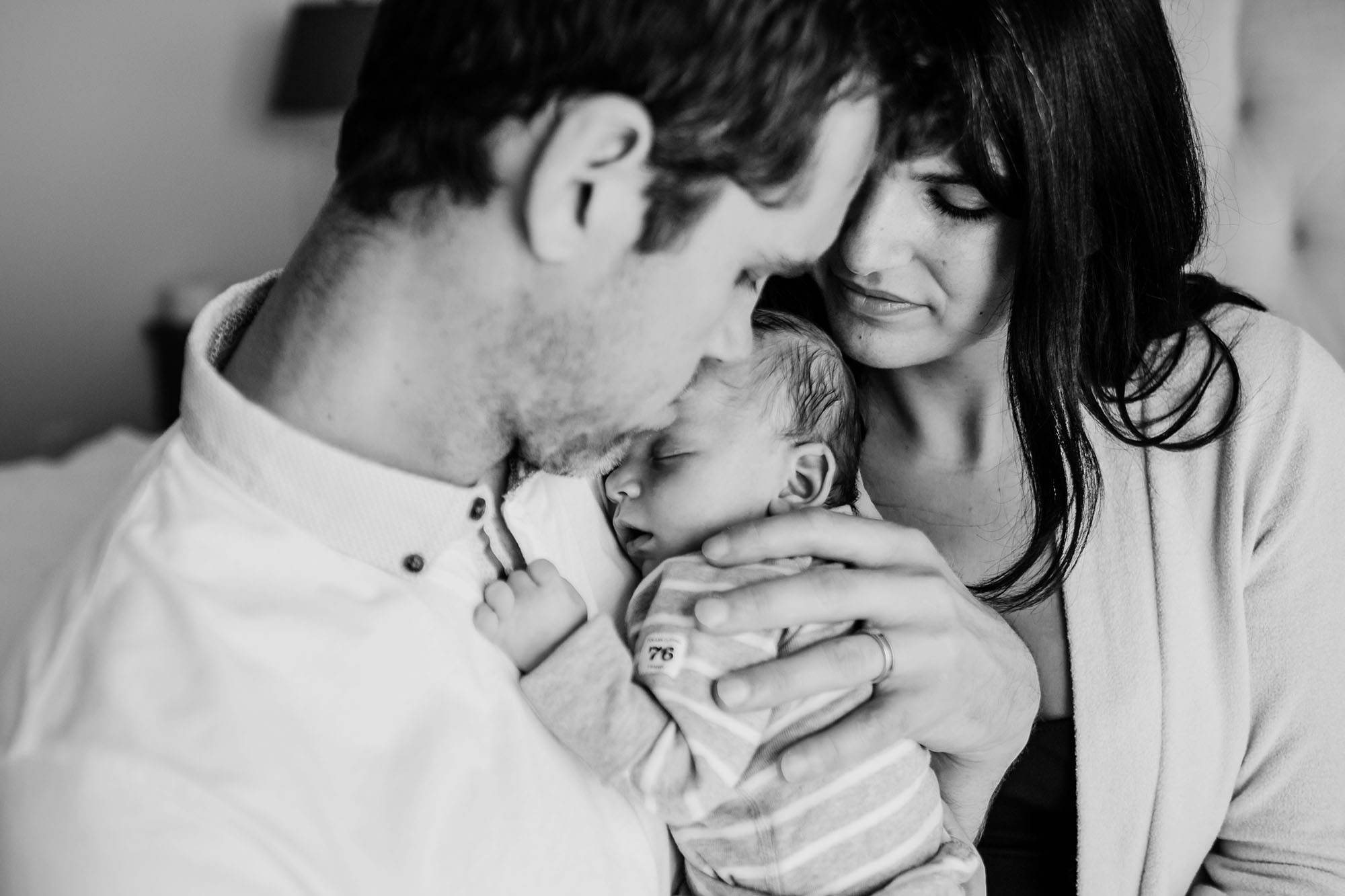 father holding infant, mother, newborn lifestyle photography