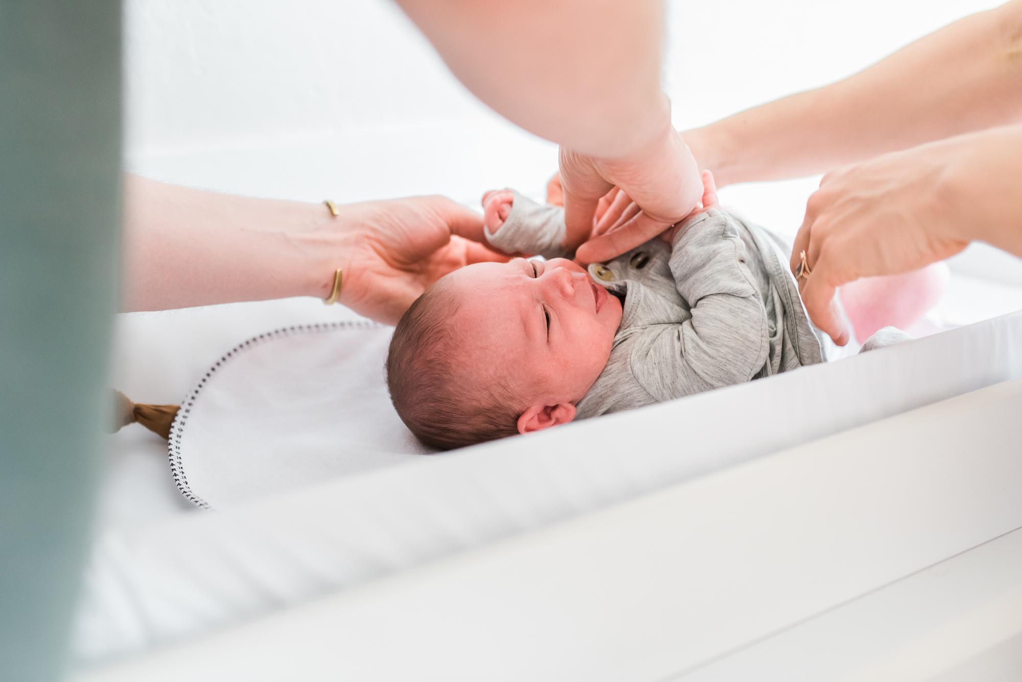 southwest theme nursery, nursery decor, parents with baby in nursery, newborn lifestyle photos